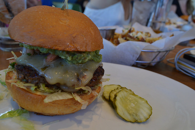 Grab a Juicy Burger at Café Deluxe, a French-American Eatery Minutes from Cathedral Commons